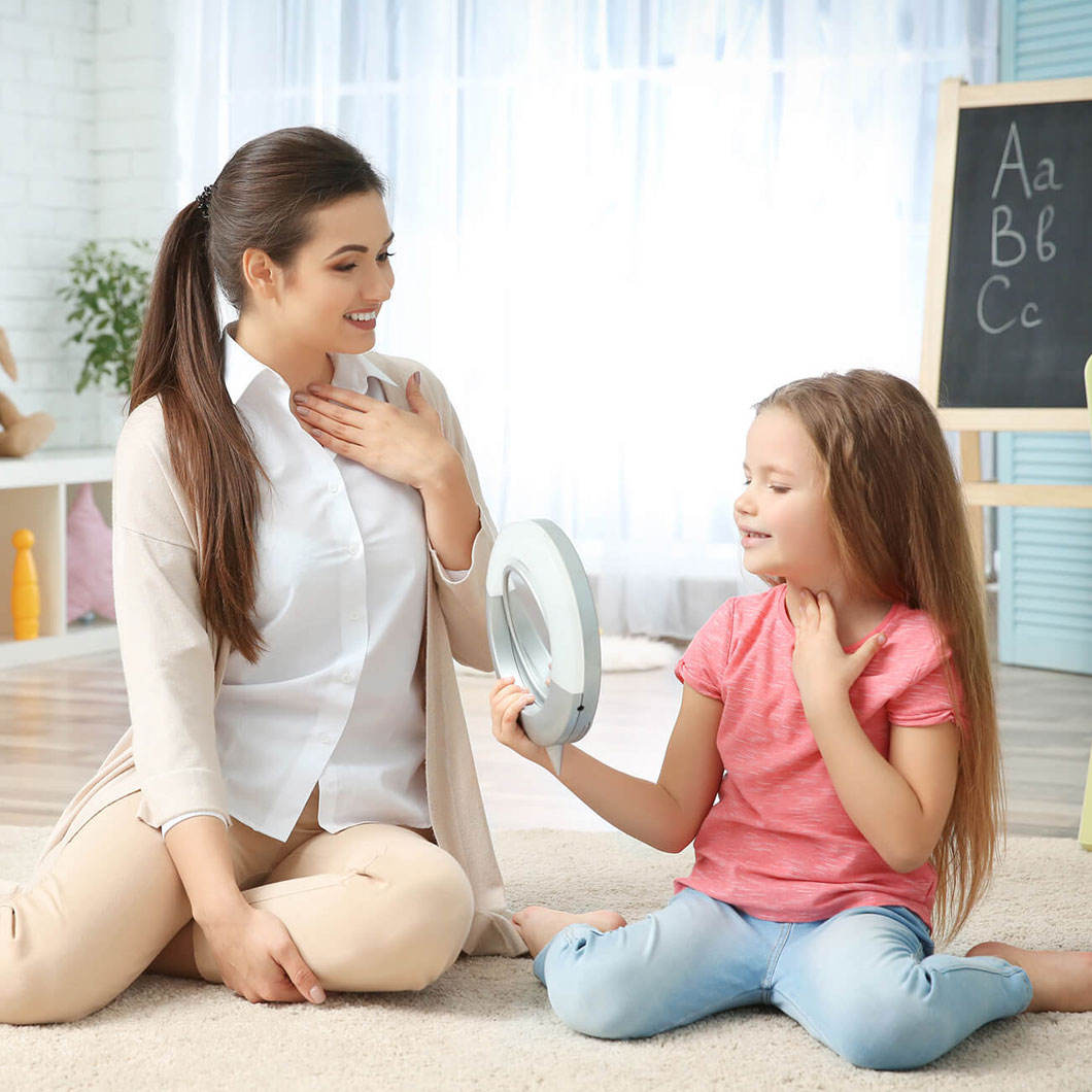 A therapist giving home-based ABA therapy to a girl with Autism